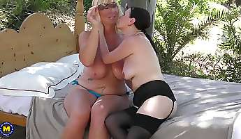 older lesbian beauties kissing and sucking tits at the pool