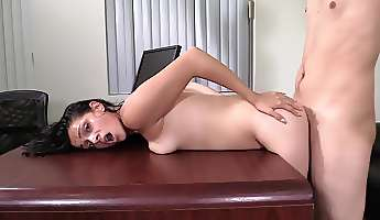 casting guy bends her over a desk and fucks her doggystyle
