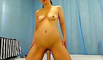 brunette aurelia gold playing with a long rubber phallus