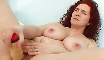 redhaired dumb mom fucks herself with a fake plastic penis