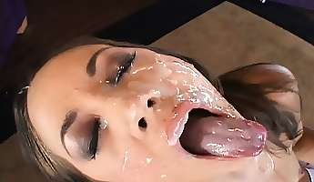 pretty brunette with lovely boobs gets her face covered with warm jizz