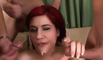 redheaded milf is getting drilled everywhere in a gangbang and gets a facial