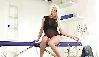 a lovely blonde teases her clit in front of us in the solo video