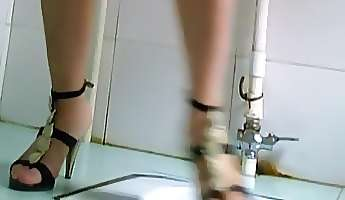 european girl in high heels pissing on the toilet