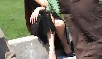 vagina showing upskirt of a horny redhead in a park
