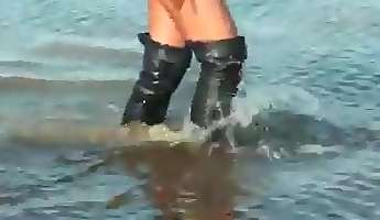 black thigh high boots in the mud