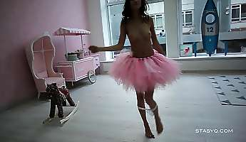 sveta dancing wearing a pink ballerina tutu dress