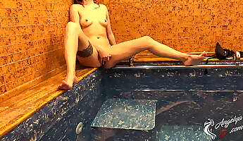 girl bathing in the pool and jerking pussy while no one is near